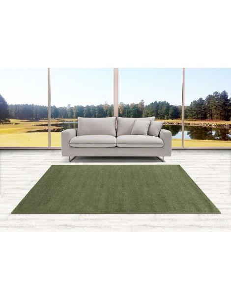 Ambientazione del tappeto verde a tinta unita